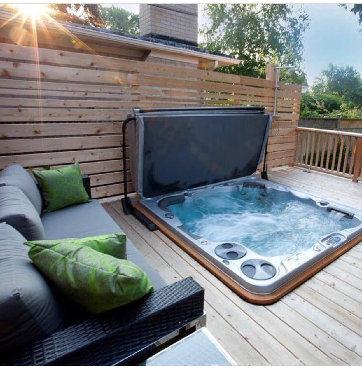 hydropool serenity hot tub installation with outdoor furniture