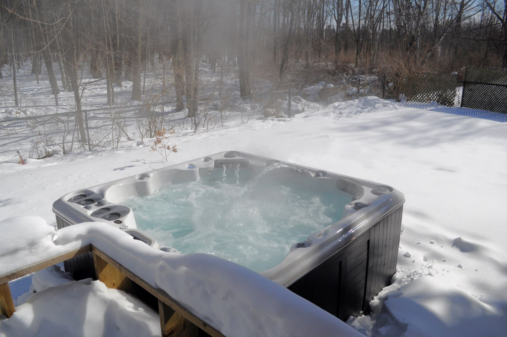 hot tub surrounded by snow