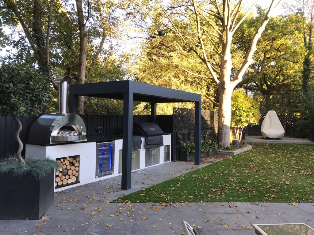 Outdoor kitchen design includes Fire magic grills and alfa pizza ovens.